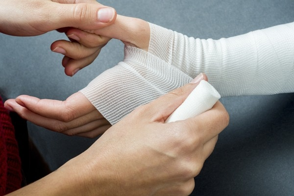 Picture of nurse treating wound care